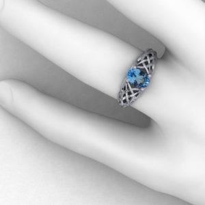 Artistic Blue Topaz Woven Ring
